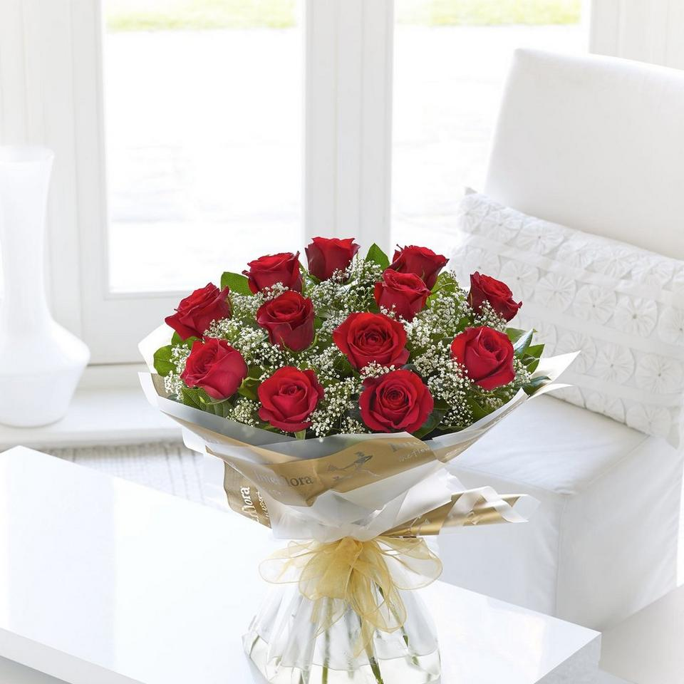 Image 1 of 1 of 12 Red Long Stem Roses Hand-tied