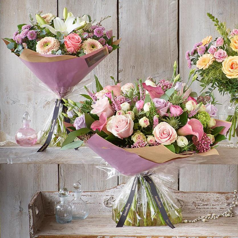 three-pastel-bouquets-on-shelves-banner