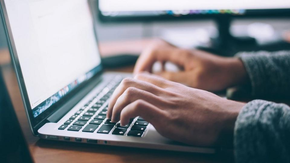 typing-on-computer-stock-image